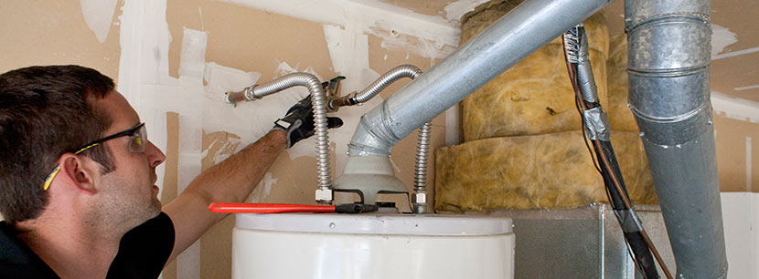 Jack is one of our plumbers in Longmont, Colorado and he is fixing a water heater unit